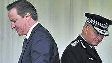 Britain's PM David Cameron and Metropolitan Police Commissioner Paul Stephenson during a memorial ceremony in London last year