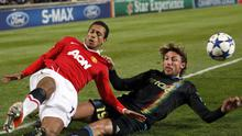 Marseille's Gabriel Heinze, right, tackles former Manchester United team-mate Nani during the Champions League last 16 game in France last night. Photo: Reuters