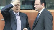 ECB president Jean-Claude Trichet talking to Greek Finance Minister George Papaconstantinou at the start of a meeting of eurozone finance ministers at the European Union Council in Brussels yesterday. Photo: Reuters
