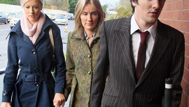 Hazel Stewart  (centre) with her daughter Lisa and son Andrew arriving at Antrim Crown Court. PA
