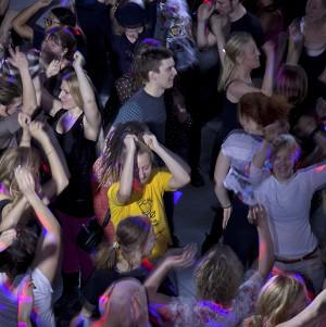 People dance during the Lunch Beat event at a cultural centre in central Stockholm (AP)