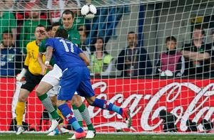 Croatia's Mario Mandzukic (blue shirt) scores against Ireland