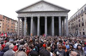 """People gather during a demonstration of solidarity in front of Rome's Pantheon for the victims of the explosive device that went off near the """"Francesca Morvillo Falcone"""" high school in Brindisi, Italy, Saturday. Photo: AP"""