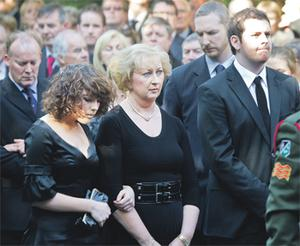 Brian Lenihan's brother Conor, daughter Claire, wife Patricia and son Tom follow his coffin at his removal last night