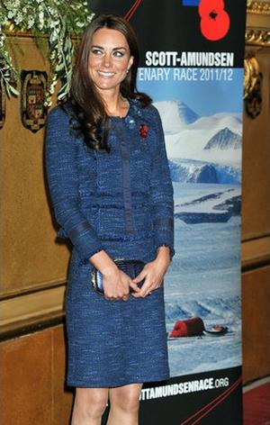 Kate wears a Rebecca Taylor blue tweed suit.