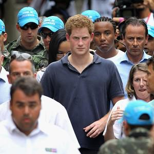 Prince Harry is surrounded by a huge security cordon as he tours the fvella of Complexo do Alemao in Rio De Janeiro, Bazil