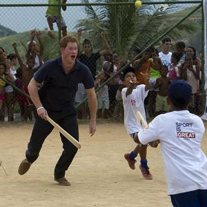Prince Harry plays Taco Ball during a visit to the favella of Complexo do Alemao in Rio De Janeiro, Brazil