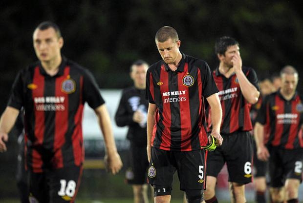 Dejected Bohemians players Mark Quigley, Jason McGuinness, Ken Oman and Owen Heary leave the pitch at the end of the game. Photo: David Maher / Sportsfile