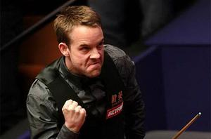 Ali Carter celebrates his 13-12 victory over Judd Trump in the second round match during the Betfred.com World Snooker Championships. Photo: PA