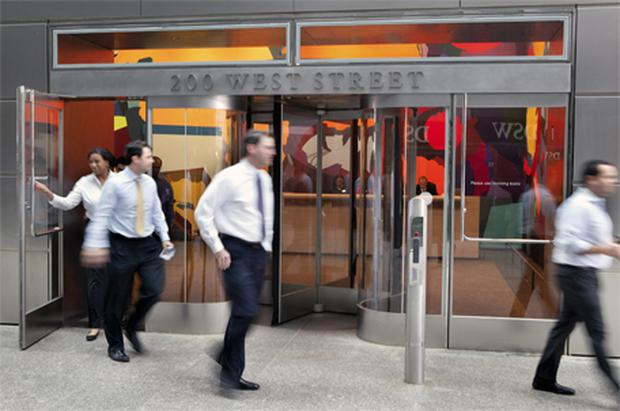 People exit Goldman Sachs Group's new headquarters building at 200 West Street in New York. Photo: Bloomberg News