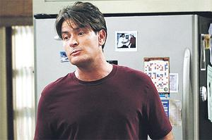 Winners drink tiger juice: Charlie Sheen, left, and Angus T Jones in sitcom Two and a Half Men