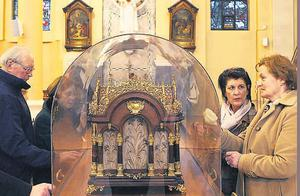 Revered: Worshippers at the Carmelite Church on Whitefriar St in Dublin view the relics of St Thérèse of Lisieux