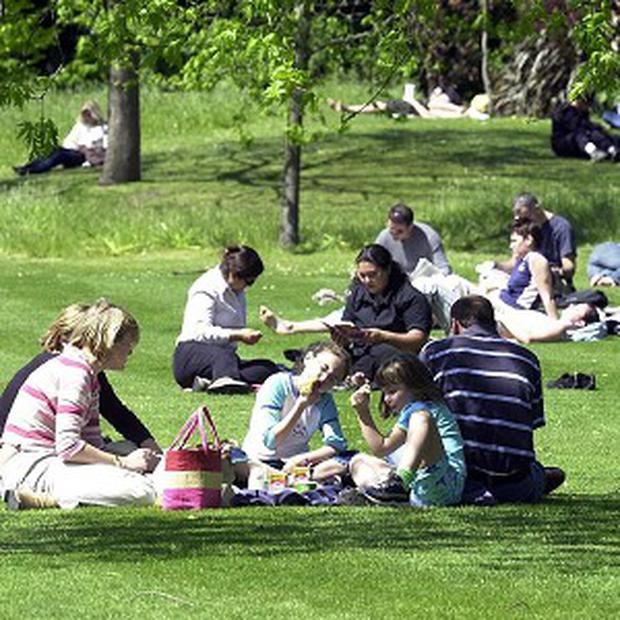 A family using a windbreak while having a picnic were ordered to remove it