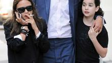 Mary-Kate Olsen with Olivier Sarkozy and his daughter.