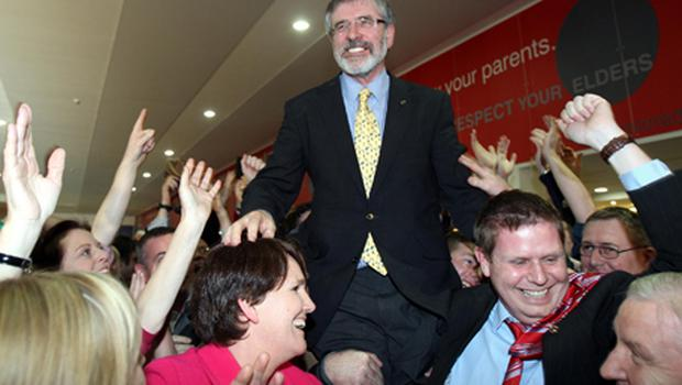 Sinn Fein President Gerry Adams is lifted by supporters, after being elected TD, in Co Louth. Photo: PA