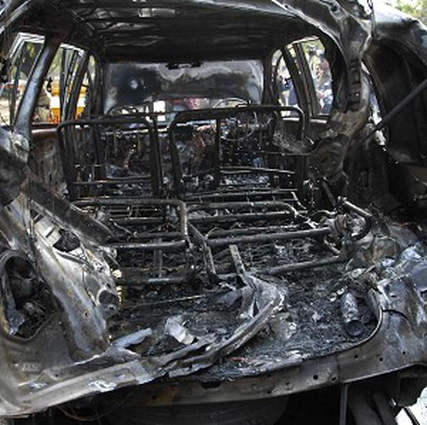 The wreckage of a car belonging to the Israel Embassy that was destroyed in a blast in New Delhi (AP)