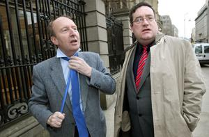KNOT AGAIN: From left, senator Shane Ross (independent candidate in Dublin South) arrives at Leinster House with senator Dan Boyle (Green candidate for Cork South Central) for the Seanad debate on the Finance Bill yesterday. Photo: Tony Gavin