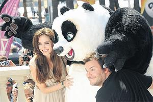 Actress Angelina Jolie, left, and actor Jack Black attend the 'Kung Fu Panda 2' photocall during the 64th Annual Cannes Film Festival yesterday