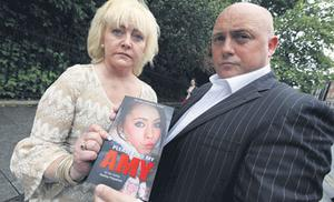 Audrey Fitzpatrick and her partner Dave Mahon, with her book about the hunt for Amy