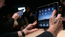 Guests play with the new Apple iPad during the Apple Special Event. Photo: Getty Images