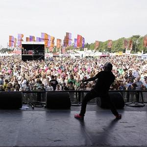Festival-goers at WOMAD attempt to break the world record for the largest number of people playing air guitar (Action on Hearing Loss/PA)
