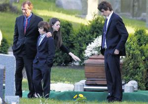Robert F. Kennedy Jr., left, and his children turn away after paying their respects at the casket of Mary Richardson Kennedy, in St. Francis Xavier Cemetery in Centerville, Mass., Saturday, May 19, 2012. Mary Richardson Kennedy.