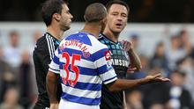 Chelsea captain John Terry (right) speaking with QPR's Anton Ferdinand. Photo: PA