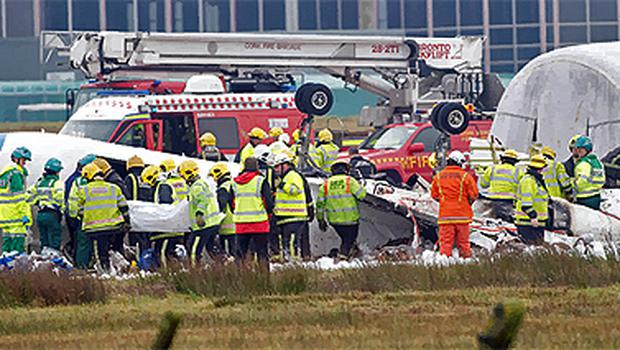 The scene at Cork Airport as emergency workers workers tend the wreckage of the Manx 2 flight