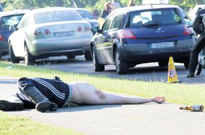 A man at the Swedish House Mafia gig in Dublin sprawls out on the path after drinking