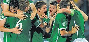 Irish players celebrate after their 0-0 draw against Romania in Bucharest last night