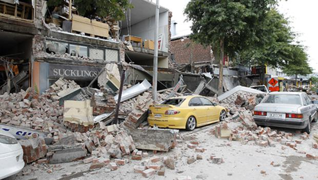 Cars covered in building debris in Christchurch after the earthquake. Photo: Getty Images