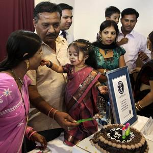 Jyoti Amge celebrates after gaining the title of the shortest woman in the world in Nagpur, India (AP)