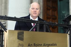 Fine Gael finance spokesman Michael Noonan arrives for a briefing by Department of Finance officials yesterday