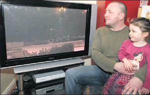 John Smith from Marley's Lane with his daughter Erin viewing the footage of the strange objects.