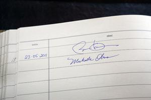 The signatures of US President Barack Obama and First Lady Michelle Obama are seen in a visitors book at Aras an Uachtarain. Photo: Getty Images