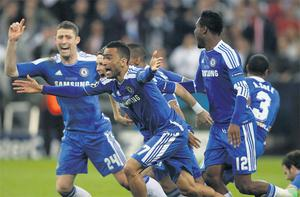 Chelsea players react with pure delight after Didier Drogba scored the winning penalty in last night's Champions League final