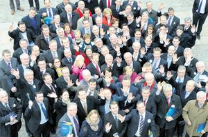 Fine Gael's Enda Kenny was surrounded yesterday by some of the 102 candidates his party is running in the general election next month
