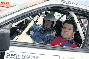 Ruaidhri O'Connor gets ready to hang on to his seat as he joins Kenny McKinistry for a spin around Nuttscorner Oval