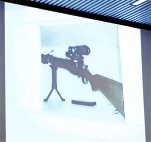 A projection screen displays pictures of equipment and materials used by Norwegian mass killer Anders Behring Breivik.