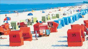 Rows of strandkorb wicker chairs along the German Riviera
