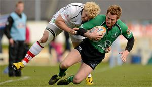 Gavin Duffy, Connacht, is tackled by Paddy McAllister, left, and Ian Humphreys, right, Ulster. Celtic League, Connacht v Ulster, Sportsground, Galway. Photo: Sportsfile