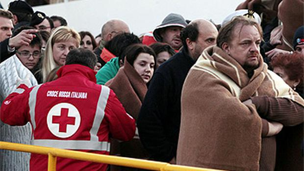 Passengers evacuated from the Costa Concordia arrive on a ferry in Porto Santo Stefano, Italy