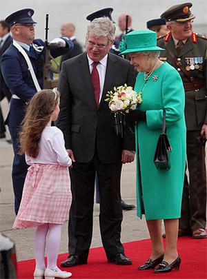 Queen Elizabeth II holds a posy of flowers given to her by eight-year-old Rachel Fox from Dun Laoghaire, south Dublin. Photo: PA
