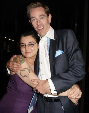 Sinead O'Connor hugs Ryan Tubridy after 'The Late Late Show' at RTE Studios on September 2, 2011 in Dublin, Ireland.