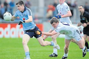 Dublin's Emmett O Conghaile tries to get away from Kildare's Tony Gibbons at Parnell Park last night