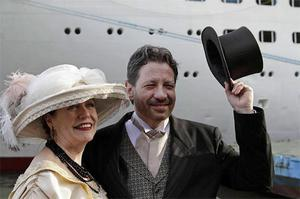 Mary Beth Crocker, left, and her husband Tom Dearing from Newport Ky. pose for pictures in period costume as they disembark the MS Balmoral Titanic memorial cruise ship at its first stop in Cobh, Ireland, yesterday. Photo: AP