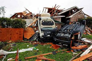 Damaged cars are seen amid the debris after a tornado struck a residential neighborhood in Lancaster, Texas.
