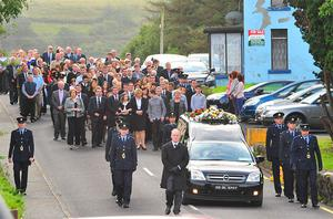 Mourners at the funeral today.
