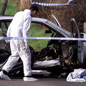 Forensic experts at the scene of the explosion in Lurgan, Co Armagh, in March 1999 which killed solicitor Rosemary Nelson
