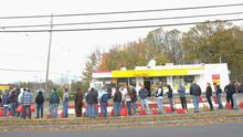 MATAWAN, NJ - NOVEMBER 02:  People line up to fill gas canisters at a Shell gas station on November 2, 2012 in Matawan, New Jersey. According to AAA, 60 % of gas stations in New Jersey are or were closed due to Superstorm Sandy.  (Photo by Michael Loccisano/Getty Images)
